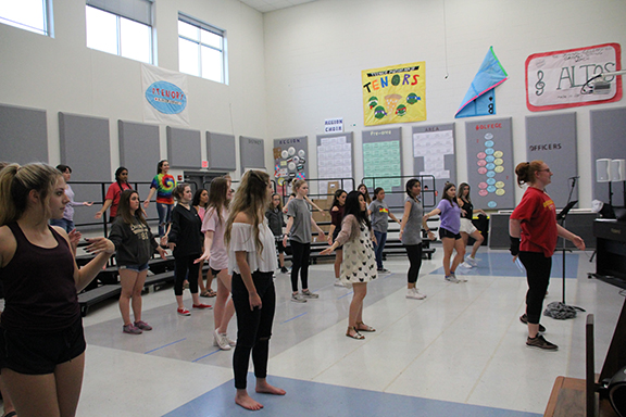 Non-varsity women rehearse their numbers after school.