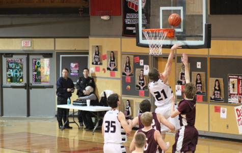Boys Basketball Destroys Tiger Tie, Secures Playoff Spot