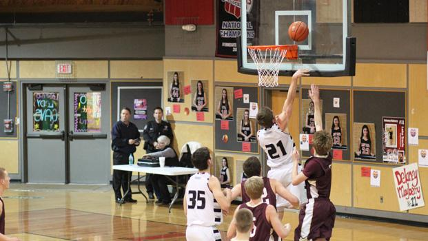 Dakota Prukop completes a drive to the basket against Dripping Springs last Friday night at Lake Travis High School.