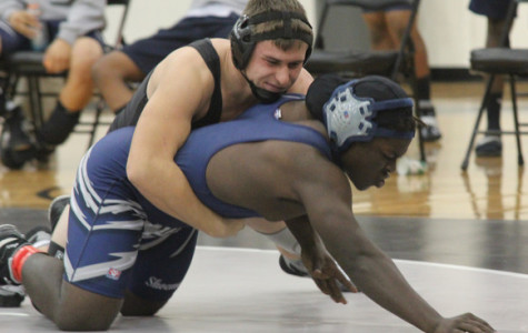 Junior Harrison Holmes goes in for the win against one of his toughest opponents. On Dec. 5 the team went up against Shoemaker and came away with a win. Submitted photo.