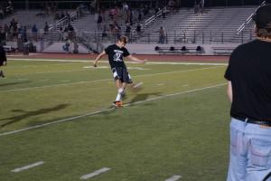Sophomore Drayton Whiteside kicks for boys basketball.