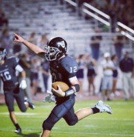 QB Jamie Hudson celebrates a touch down at the Vandegrift vs. McNeil game