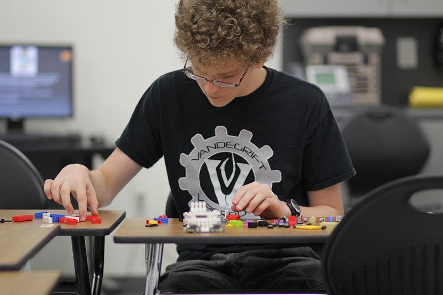 Junior Eddie Bates builds a  personal model with LEGOS at the club.