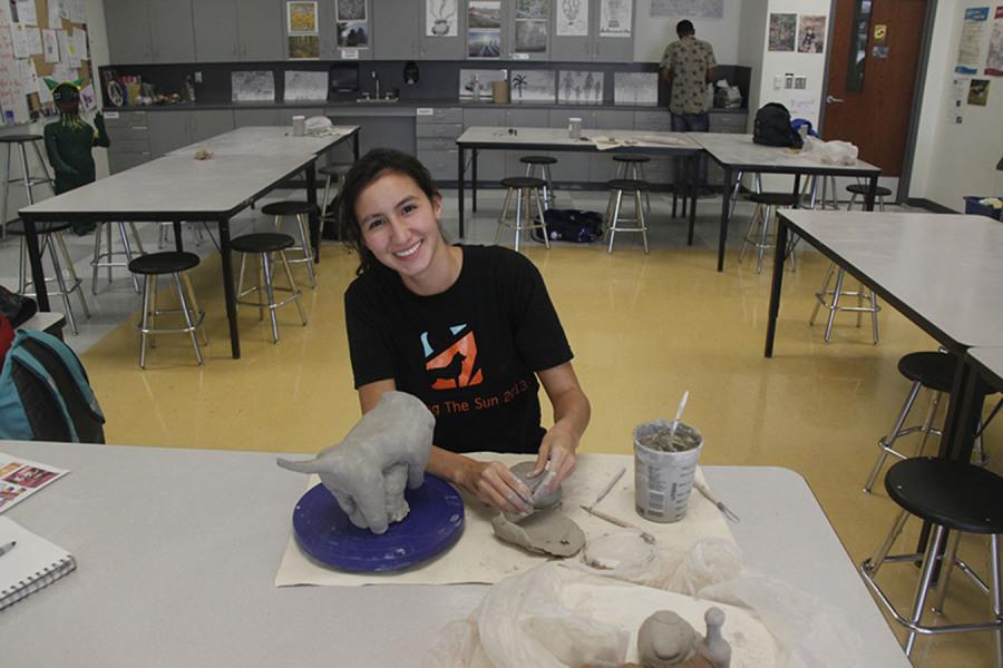 Ceramics students craft totems representing themselves