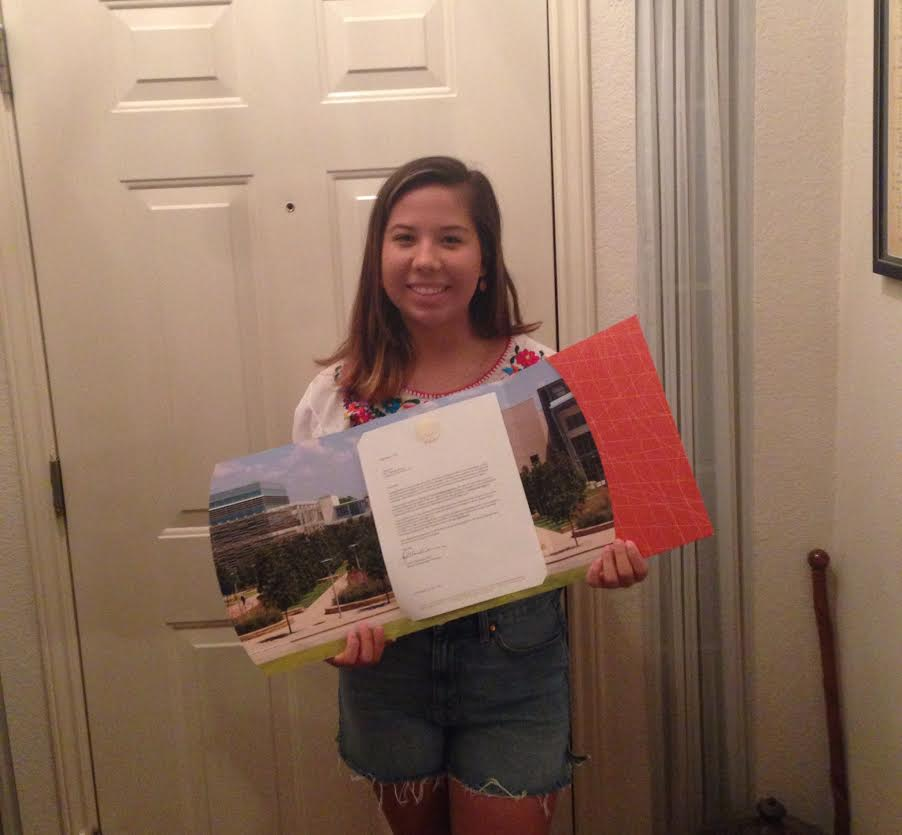 Senior Jill Fry displays her acceptance to the  University of Texas at Dallas.