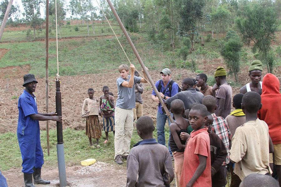 Greyson Witt drilling a well in Rwanda