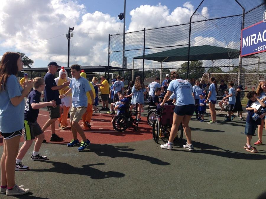 Students volunteering at Miracle League