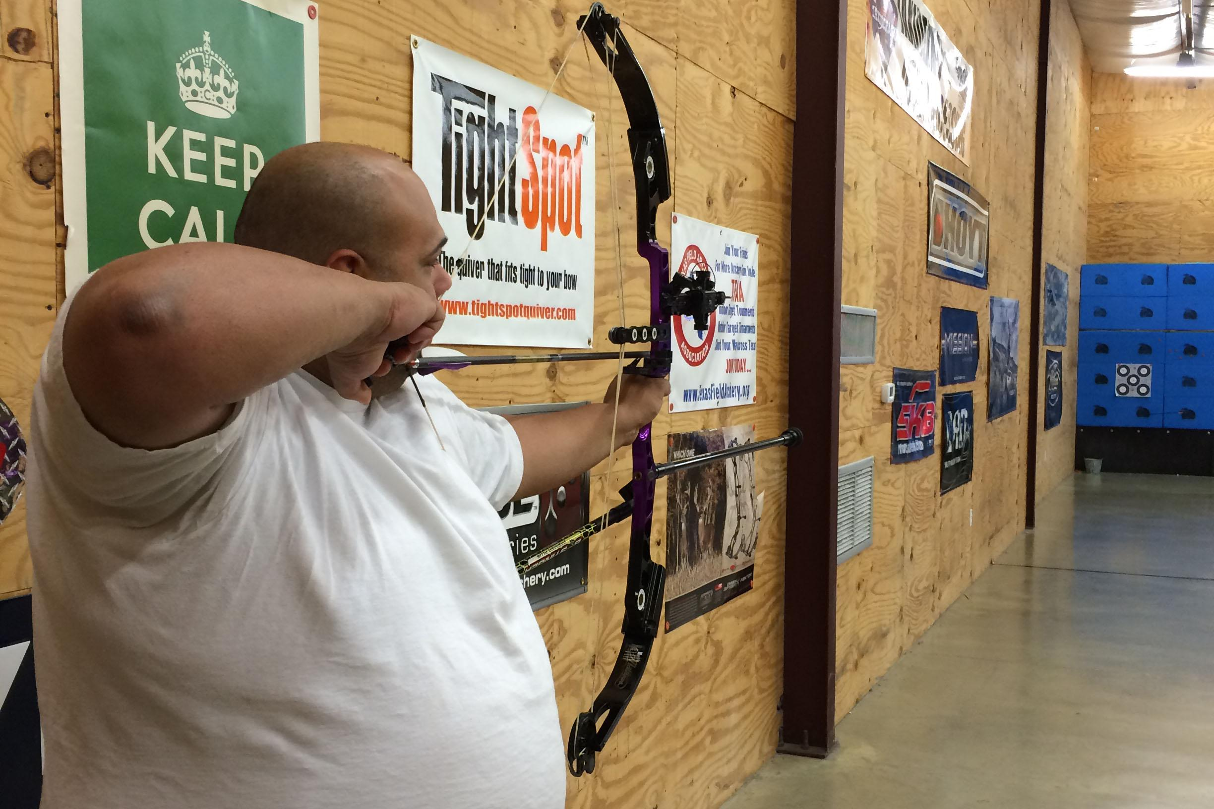 Roland Rocha prepares to shoot from his compound bow.