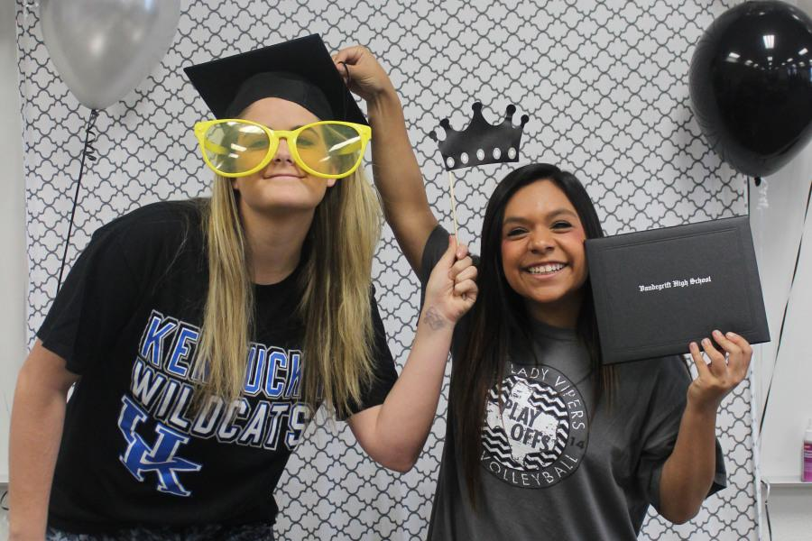 Seniors+Morgan+Waggoner+and+Kriston+Guerra+pose+for+available+photo+booth+at+The+Cookies+for+College+event.