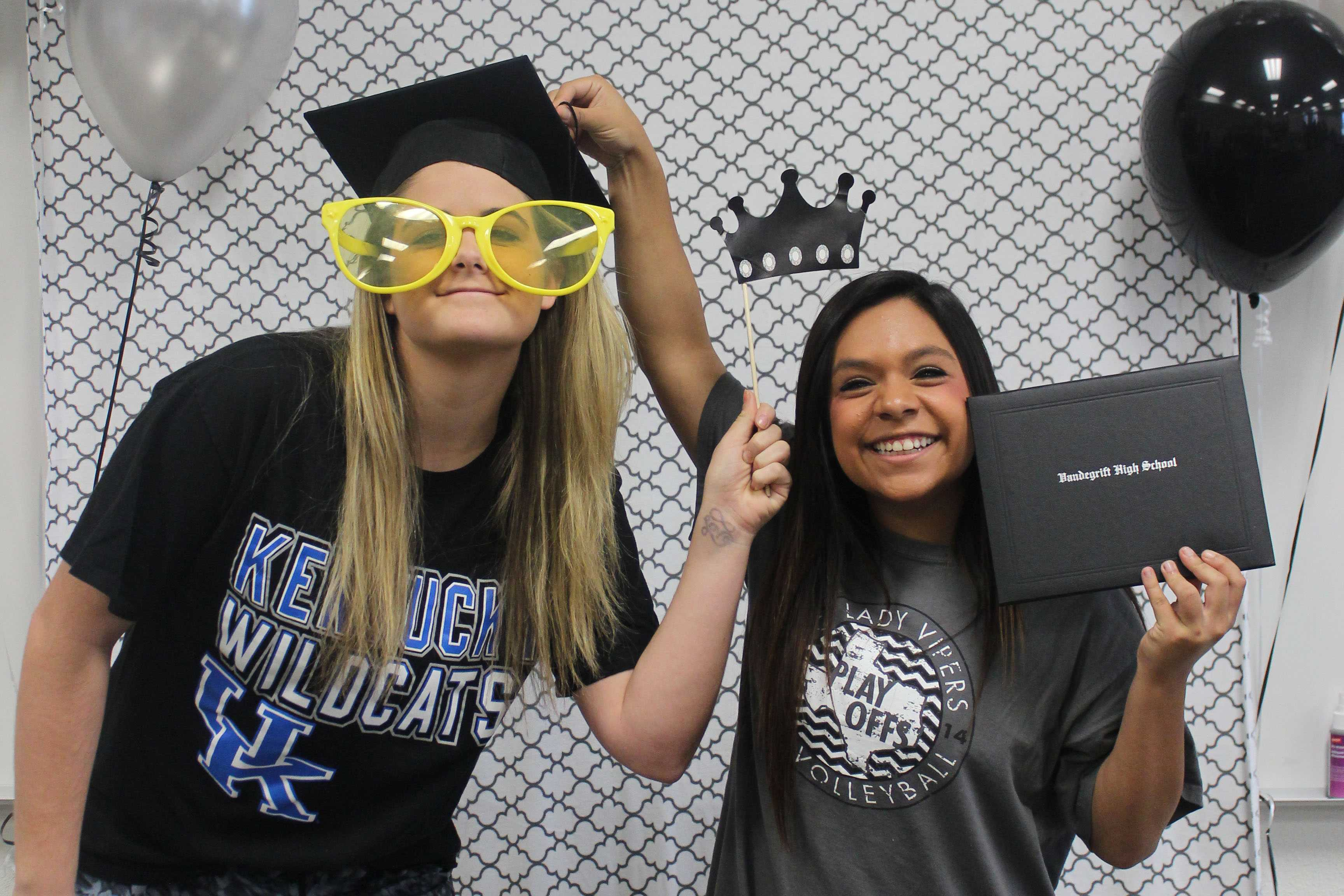 Seniors Morgan Waggoner and Kriston Guerra pose for available photo booth at The Cookies for College event.