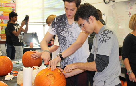 International students carve pumpkins for the first time