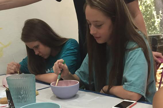 The volleyball teams painted bowls over the weekend at Ceramics Bayou that will later be auctioned off with the proceeds benefiting Austin homeless shelters.