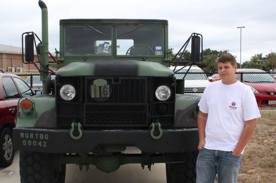 Junior Ethan Atencio next to his truck