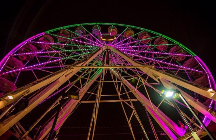 The trail of Lights adorns a Ferris wheel with colorful lights to celebrate its 50 year anniversary.