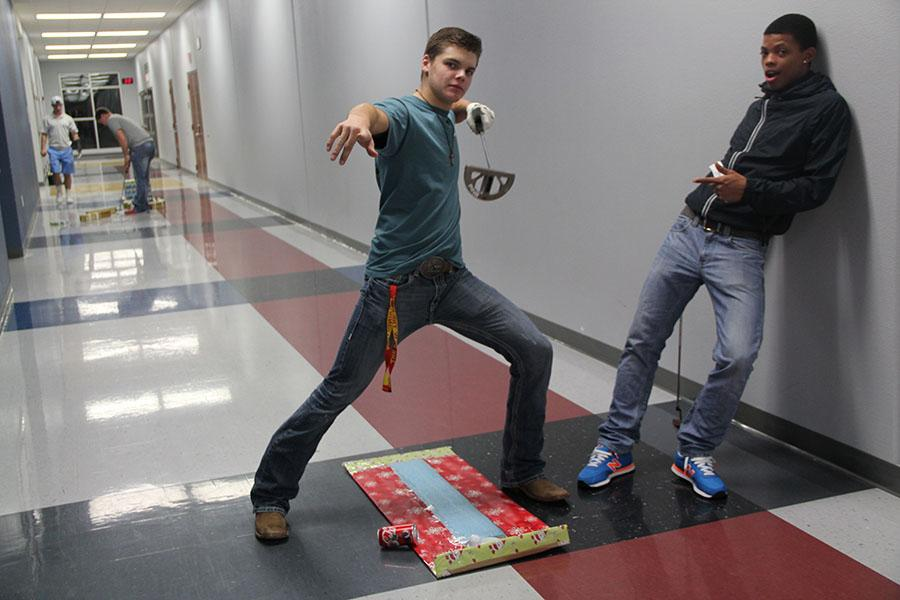 Juniors Garrison Spring  and Qwevonte Eure  pose while playing a round of Christmas Mini Golf  during the FCA miniature golf tournament.