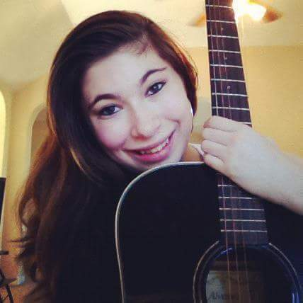 Junior Teghan Himelfarb posing with her beloved guitar.