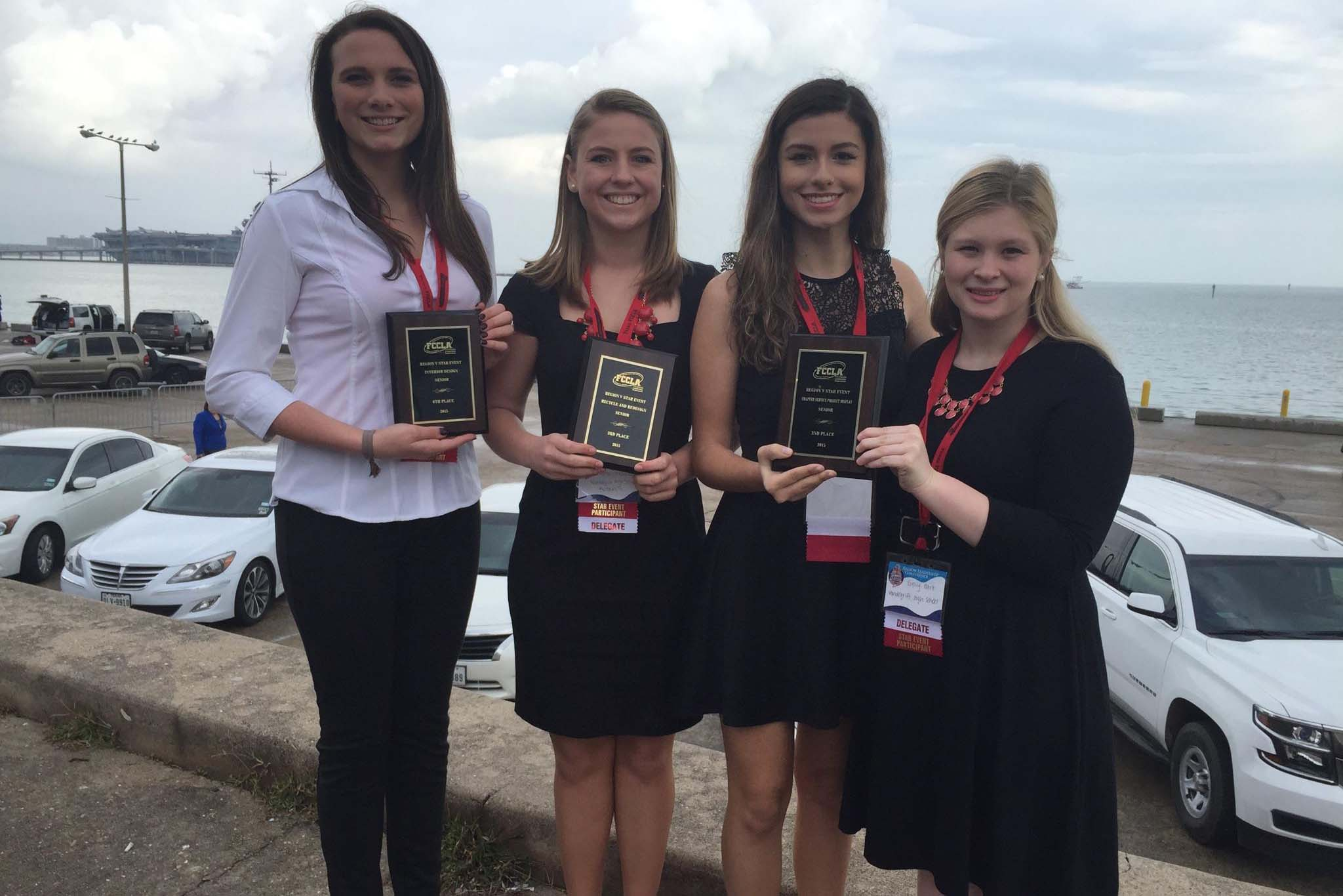 FCCLA members hold their district awards after the STAR competition in Corpus Christi.
