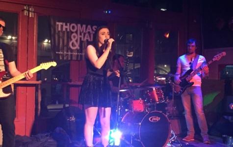 Kelsey Hewett sings in spotlight