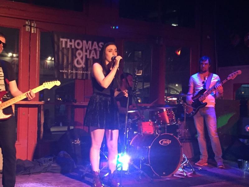 Kelsey Hewett singing at