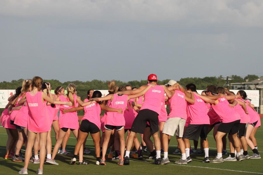 The+senior+team+circles+up+to+do+the+chant+that+Coach+Hardy+does+before+soccer+games.+They+changed+lady+vipers+to+seniors.