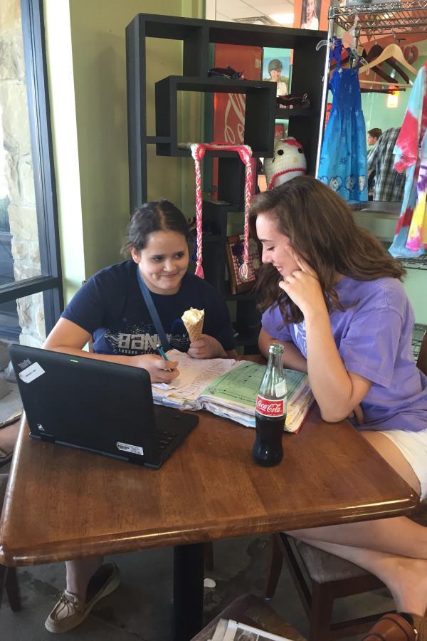 Madeleine LeBoeuf helps a student with her homework
