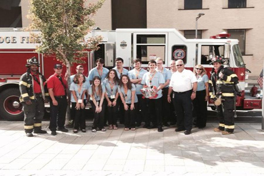 The Boston Fire Department visits the HCEF Inventeam during Eurekafest to view their product, The Dalmatian