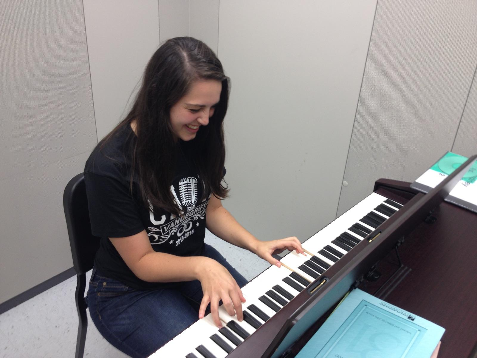 Madison Whitesides practicing her songs on the piano.