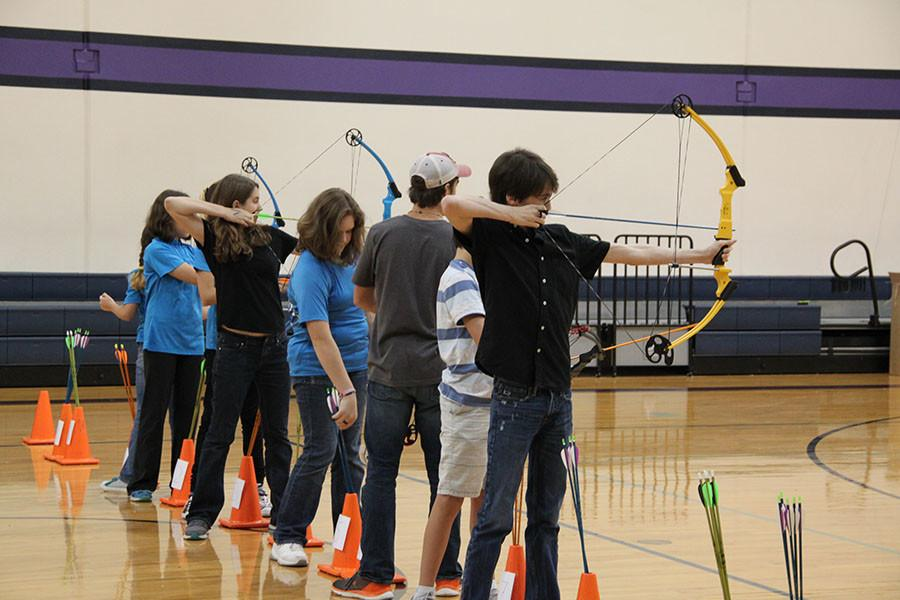 Archery students prepare to shoot the targets at the competition on Oct. 24 at Four Points Middle School.