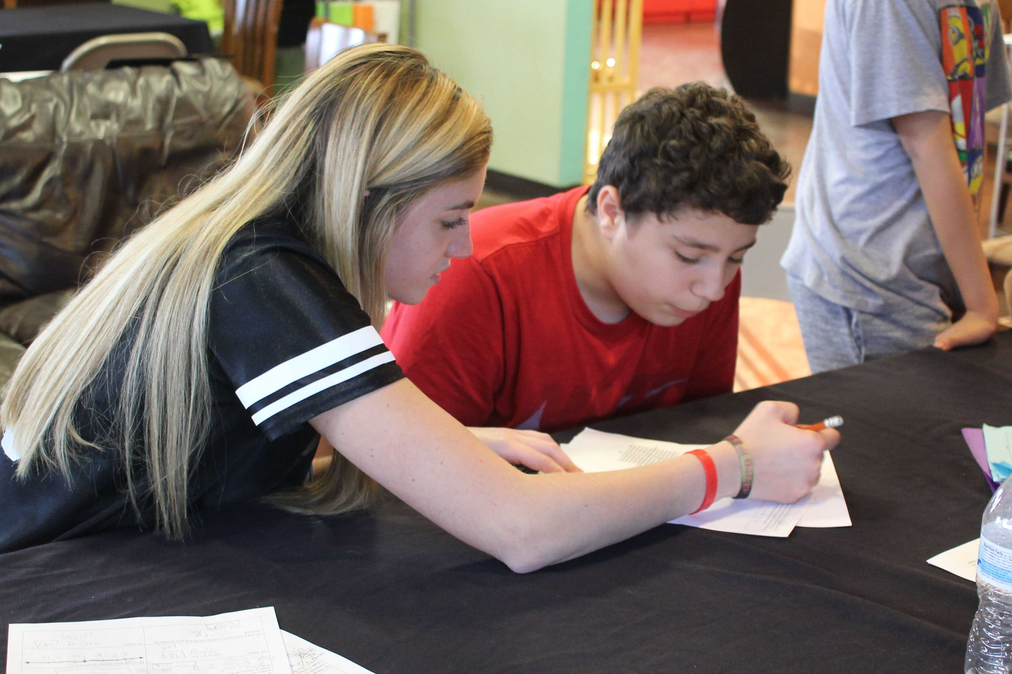 Senior Darby Wright helps a student with a math assignment.