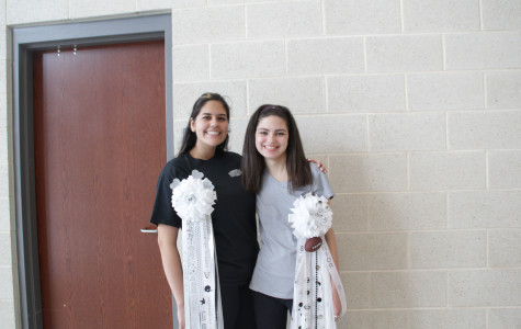 Seniors Ariana Engles and Emma Rose Floyd show off their mums