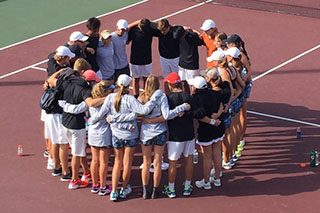 The tennis team reflects on their performance before beginning the individual portion of the State Tournament.