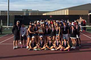 The tennis team poses with their second place trophy.