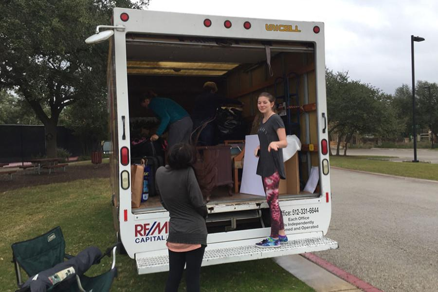 Sophomore+theatre+student+Madison+Woodrom+helps+load+the+truck+used+to+bring+the+donated+items+to+Savers.