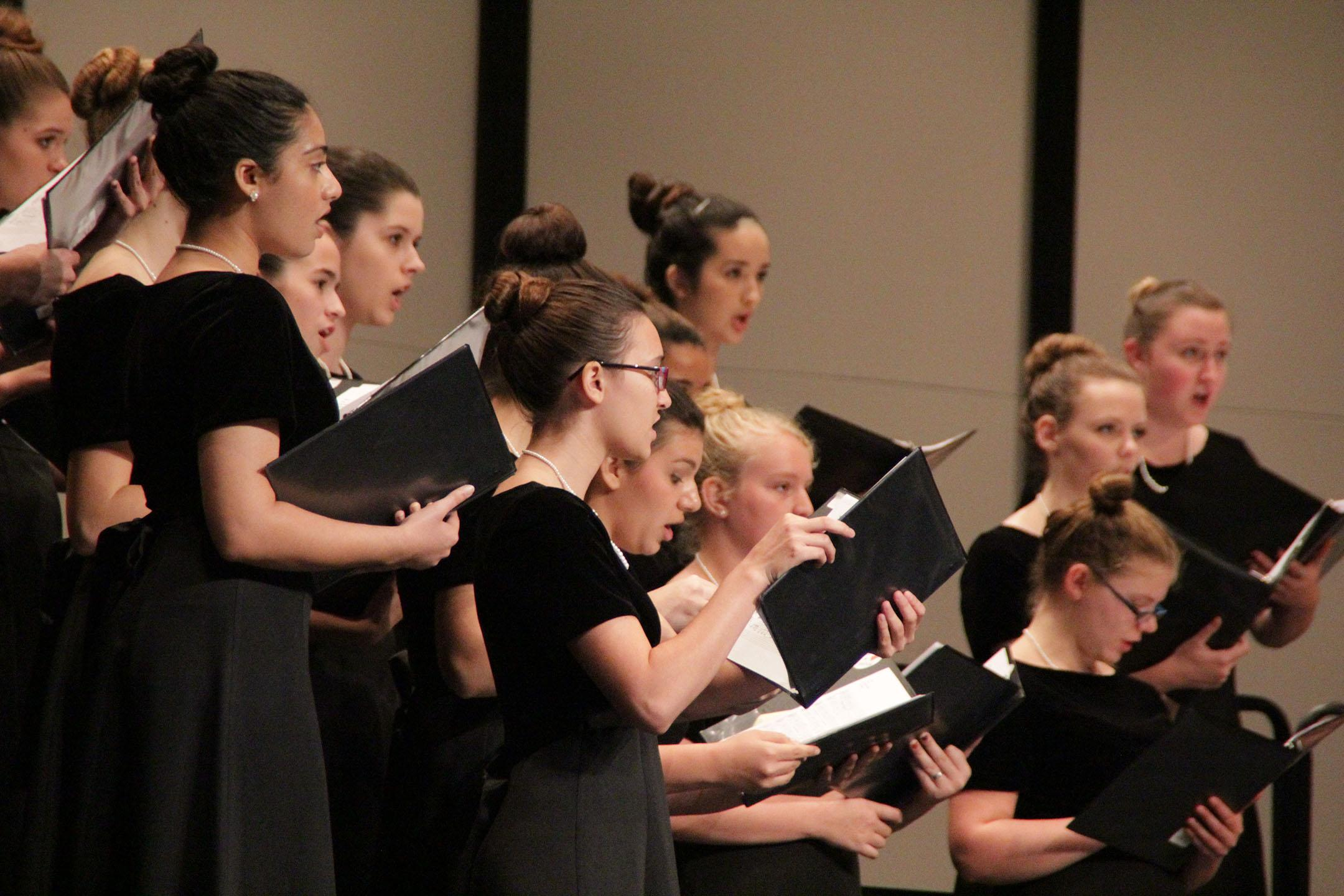 Senior Marisa Collmann sings with the choir at their Leander concert in October.