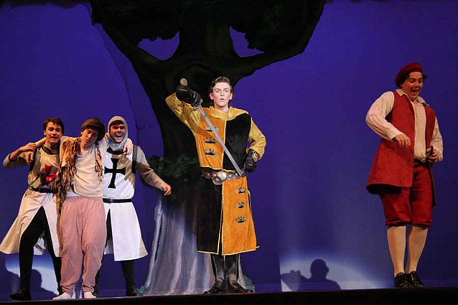 Sophomore Evan Welliver singing one of his songs in the musical: Cinderella.