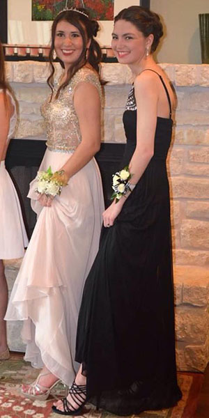 Seniors Emma-Rose Floyd and Jasmine Moreno show off their footwear before heading off to the dance floor.