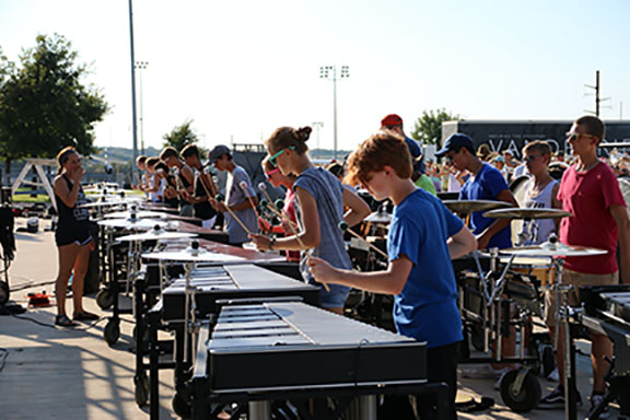 The percussion section practices the marching show.