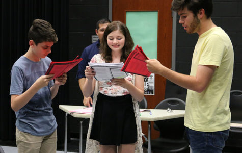 Theater students Jack Smith, Madison Woodrum, and Carlos Alvarez-Roth practice their lines at an after school rehearsal on Aug. 29.