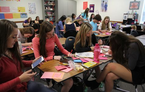 NHS members write Valentines cards for kids