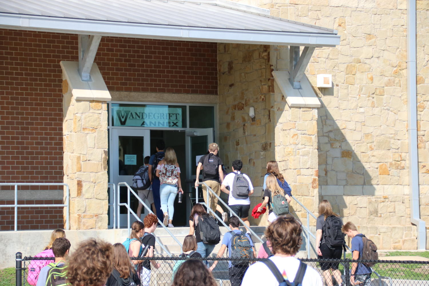 Students walk from Vandegrift to Four Points for their next class
