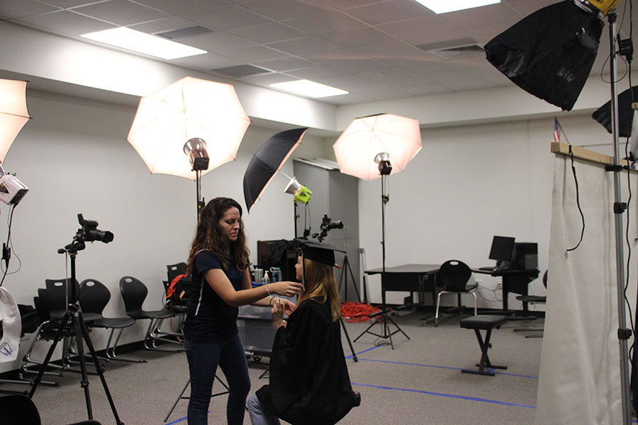 Senior Riley Collister poses for cap and gown senior portrait