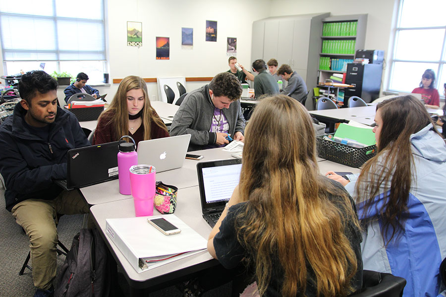 AP Research students prepare for the upcoming exam/presentation.