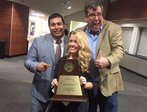 Directors Celeste Schneider (middle), John Alonso (left) and John Conner (right) pose with the advancing play trophy.