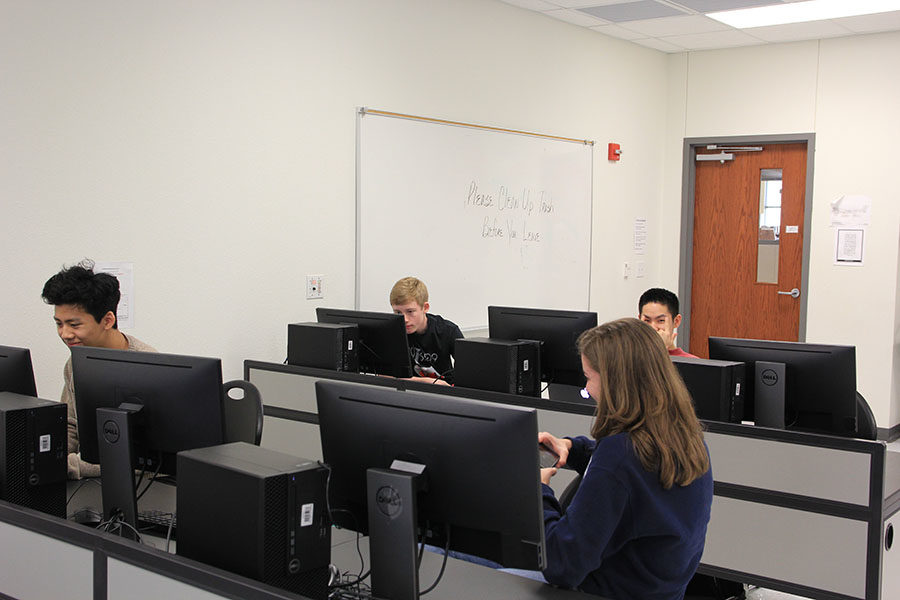 Advanced Chinese students sit in the computer lab during their class.