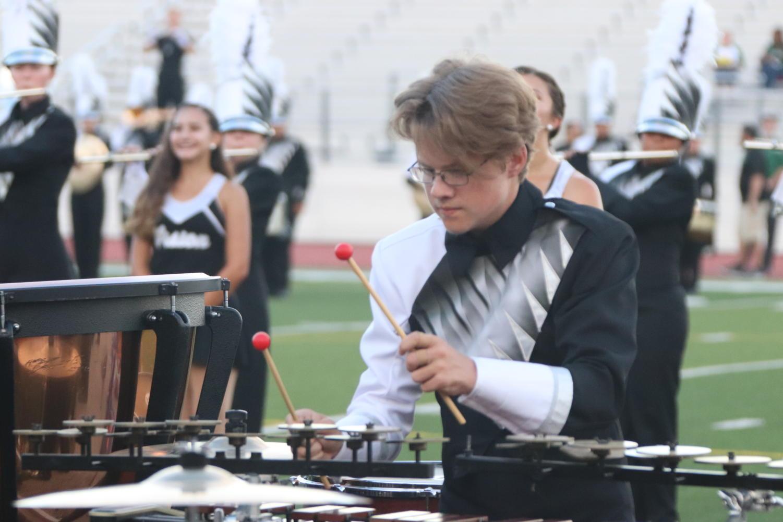 Senior Cameron Brighton plays the xylophone during a pregame performance.    Photo by Nina Castaneda