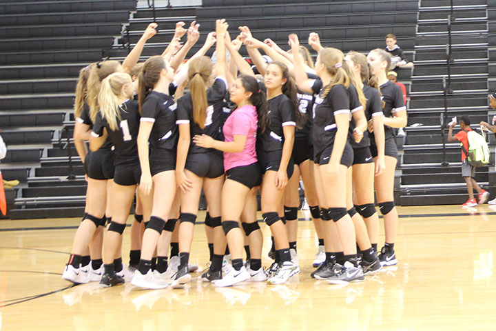 The+varsity+team+huddles+before+a+play+during+the+LISD+volleyball+tournament.
