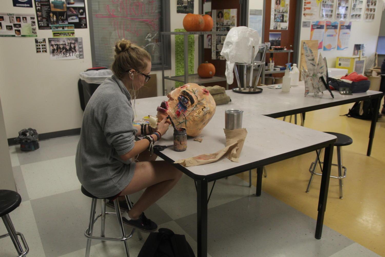 Junior Mia Rice makes her paper mache head in Ceramics.