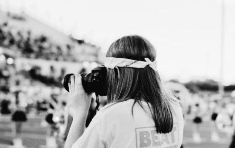 Elaina Eichorn takes pictures during pregame at the Cedar Park football game.