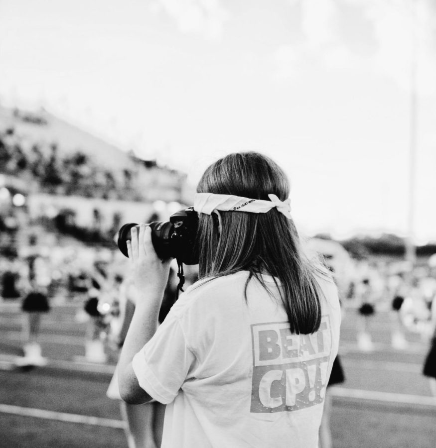 Elaina+Eichorn+takes+pictures+during+pregame+at+the+Cedar+Park+football+game.+