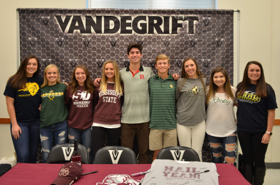 Nine+seniors+signed+on+Nov.+14+to+continue+to+play+sports+in+college.+